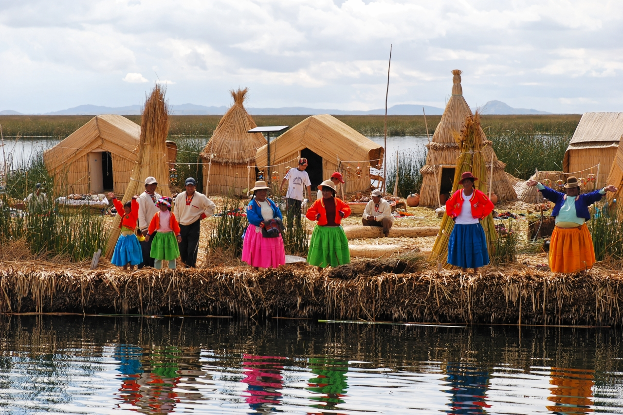 Indigenous Bolivians on one of Lake Titicaca's Floating Villages (Photo by my good friend Maarten Smit).